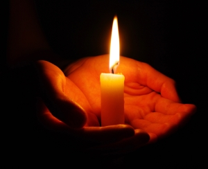 candle_hand_shutterstock_58310671